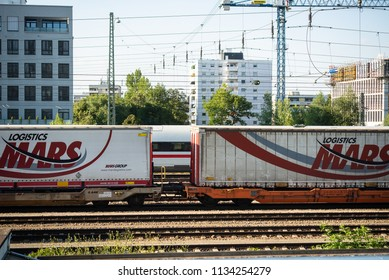 Munich,Germany-July 13,2018: a freight train loaded with container wagons rolls through Munich