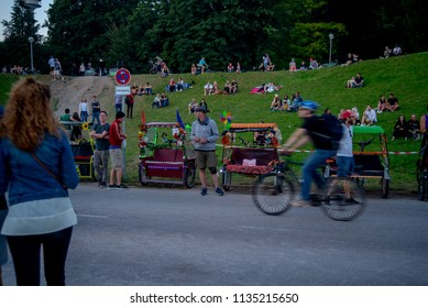 Munich,Germany-July 13,2018:  Rikshaw drivers wait for passengers outside the Tollwood Festival after sunset