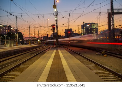 Munich,Germany-July 13,2018:  A train departs Munich Central Station after sunset causing light streaks in this long exposure