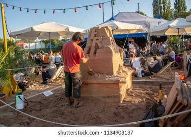 Munich,Germany-July 13,2018:An artist works on a  sand sculpture in the summer Tollwood Festival
