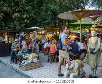 Munich,Germany-July 13,2018:People enjoy drinks in a terrace at the Tollwood Fetival