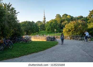 Munich,Germany-July 13,2018:People  park their bicycles along a path in Munich's Olympic Park