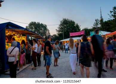 Munich,Germany-July 13,2018:People walk on the grounds of the Tollwood Festival shortly after sunset