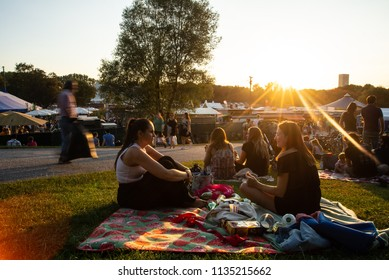 Munich,Germany-July 13,2018:People watch the sunset on a hill in Munich's Olympic Park