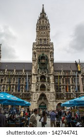 MUNICH,GERMANY-JUNE 14: Crowds gather in the Marienplatz to see the Rathaus-Glockenspiel strike noon on June 14, 2013. The Glockenspiel attracts millions of visitors annually.