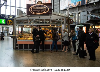 Munich,Germany-June 28,2018: Commuters arriving early in the morning buy something to eat from a bakery