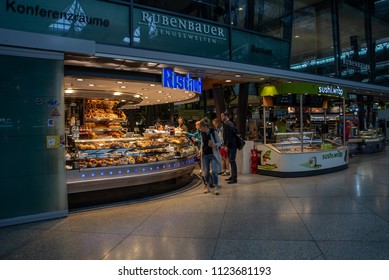Munich,Germany-June 28,2018: Commuters arriving early in the morning buy something to eat from a bakery before heading to work.