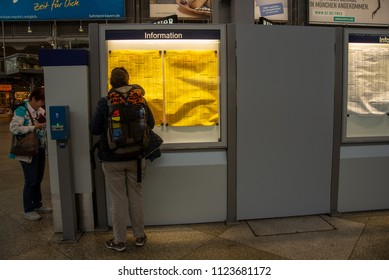 Munich,Germany-June 28,2018: A person looks at the departures schedule at Munich Central Station