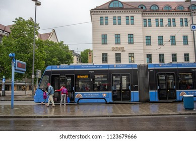 Munich,Germany-June 28,2018: A woman waits for her daughter before boarding the tram on the way to school