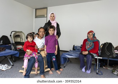 Munich-Germany-September 22, 2015 Refugee family from Afghanistan in the initial reception center for refugees in Riem, Munich