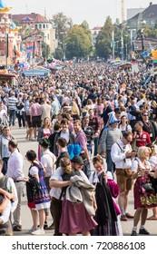 Munich,Germany-September 24,2017: Crowds walk on the Oktoberfest grounds .