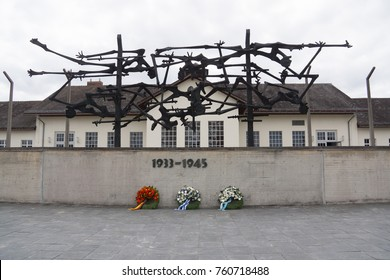 Munich/Germany-September 8 2017: Exterior of camp facilities with memorial sculpture and wall,  at Dachau Concentration Camp, Munich, Germany.