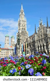 Munich's Neues Rathaus (New Town Hall) amongst some flowers in the Spring. Marienplatz, Munich.