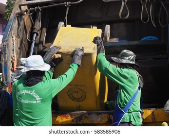 Municipal employees are pouring garbages to the garbage car in February the 20th ,2017 at Tamnawa School, Bang Pa-In Phra Nakhon Si Ayutthaya Province