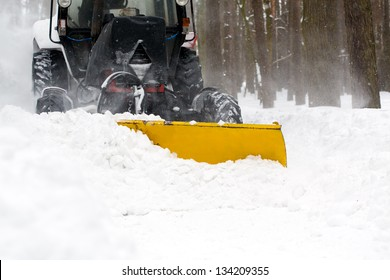 Municipal equipment removing snow from the roads in winter