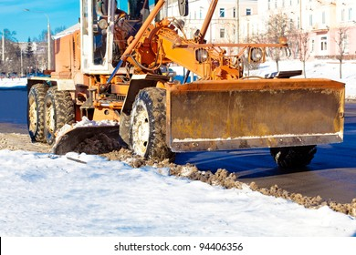 Municipal equipment removing snow from the roads in winter and cleaning streets