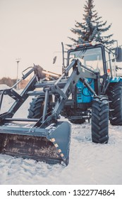 Municipal snow removal machinery - wheel dozer with front loader