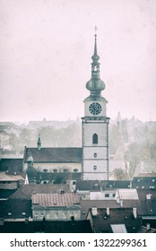 Municipal tower in Trebic, Czech republic. Travel destination. Architectural theme. Analog photo filter with scratches.