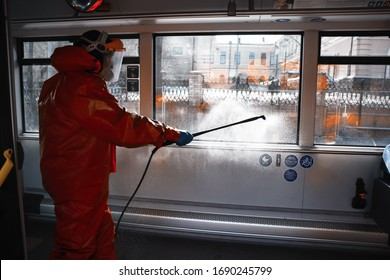 Municipality worker making the disinfection with liquid sanitizer in public transport (bus) during Covid-19 outbreak - Vilnius, Lithuania, Europe