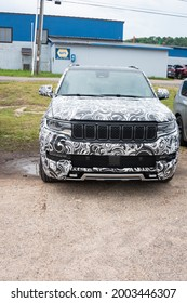 MUNISING - JUNE 26: A disguised Jeep Grand Cherokee L Prototype spotted in public.  The introduction of this new Jeep has been delayed but was tested, on June 26th, 2021 in Munising, MI, USA.