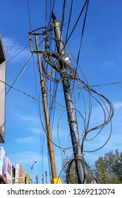 MUNNAR, KERALA, INDIA - OCTOBER 28, 2018: A utility pole supporting a mass of wiring, some haphazard, in Munnar, an Indian town in the southern state of Kerala.