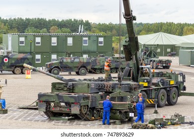 MUNSTER / GERMANY - OCTOBER 9, 2017: logistics from german army works on a main battle tank Leopard at an exercise