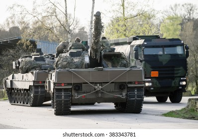 """MUNSTER / LOWER SAXONY / GERMANY - APRIL 2013: german main battle tanks """" leopard 2 a 6 """" refuel on the military training ground in munster / germany at april 2013."""
