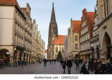 MUNSTER, NORTH RHINE-WESTPHALIA / GERMANY - DECEMBER 16, 2018: Central street before Christmas looks smart and lively.