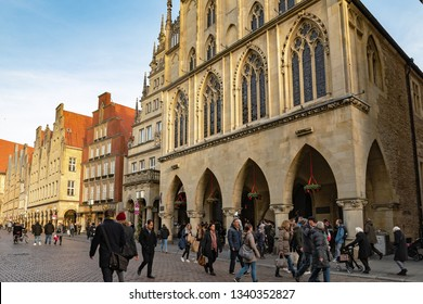 MUNSTER, NORTH RHINE-WESTPHALIA / GERMANY - DECEMBER 16, 2018: Busy street in the center before Christmas