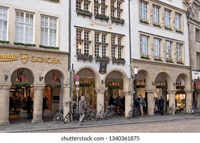 MUNSTER, NORTH RHINE-WESTPHALIA / GERMANY - DECEMBER 16, 2018: Facades of historic buildings in the city center before the Christmas holidays
