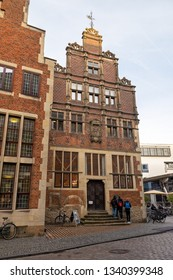 MUNSTER, NORTH RHINE-WESTPHALIA / GERMANY - DECEMBER 16, 2018: Young people are interested in a historic building in the city center.