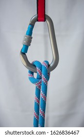 Munter hitch tied with a climbing rope to a pear shaped locking carabiner