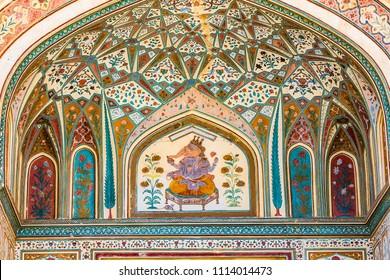 A mural of the Hindu god Ganesh at the Ganesh Pol (Ganesh Gate) at the Amber Palace in Rajasthan, India.