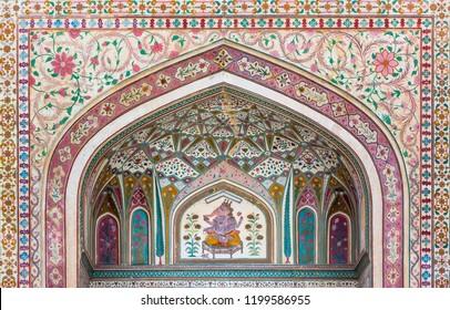 A mural of the Hindu god Ganesh at the Ganesh Pol (Ganesh Gate) at the Amber Palace in Rajasthan, India