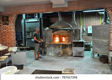 Muran, Italy - June 14, 2009: Craftsman of glass at Murano (Venice, Italy)