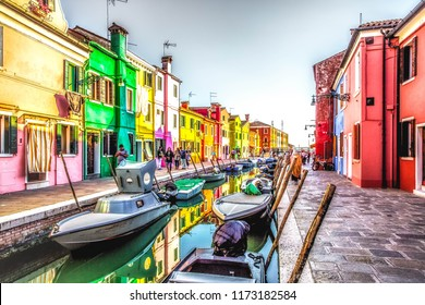 Murano, Italy: 02.11.2018:Beautiful Island murano in Venice Italy. View on canal with boat and motorboat water. Picturesque landscape.