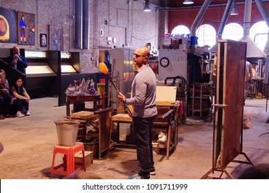 MURANO, ITALY - APR 16, 2018 - Glass blower working in a factory in Murano Venice, Italy