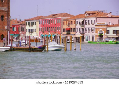 MURANO, ITALY - APR 16, 2018 - Small boats in canal on the island of Murano Venice, Italy