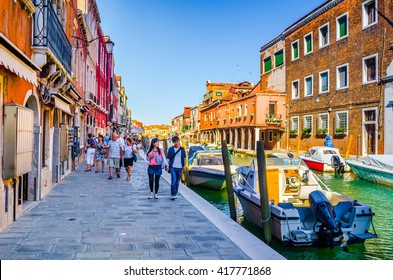 MURANO, ITALY, SEPTEMBER 20, 2015: view of a channel on murano island in italy which is surrounded with tourist shops selling famous murano glass