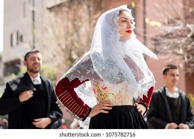 MURAVERA, ITALY - APRIL 8, 2018: 46th Citrus Festival, parade of Sardinian traditional costumes - Sardinia