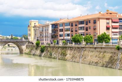 Murcia City, Murcia, Spain. June 13, 2020. Murcia city life in the Segura river and Los Peligros bridge. Cars passing and people strolling. Murcia Leisure Time.