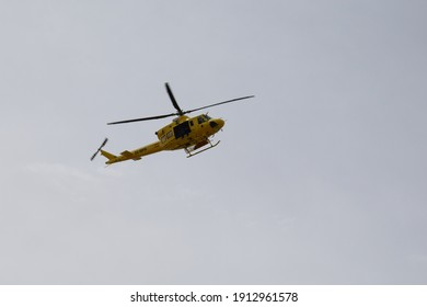 Murcia Spain 04 20 2018 An emergency helicopter flying over a disaster area