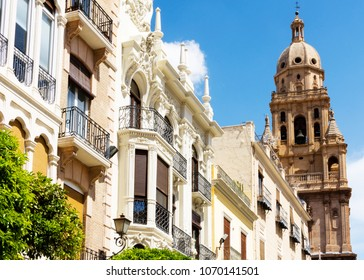 Murcia, Spain - April 14, 2018: Typical Spanish apartments with the bell tower of the Catedral de Murcia (Murcia Cathedral) a seen from Plaza del Cardenal Belluga.
