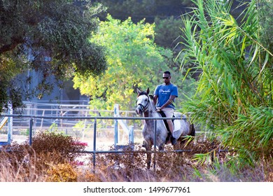 Murcia, Spain, August 28, 2019: Horse rider, riders at the sables. Sportsman riding horse inside the stable.
