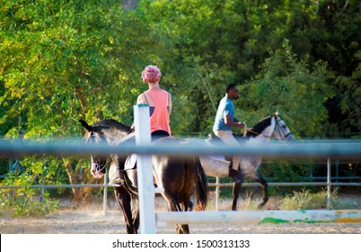 Murcia, Spain, August 28, 2019: Horse riders, rider at the sables. Sportsman and sportswoman riding horse inside the stable. Sports with animals.