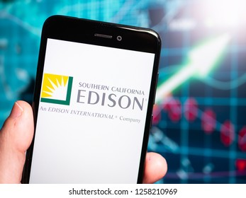 Murcia, Spain; Dic 14, 2018: Southern California Edison logo in phone with earnings graphic on background. Southern California Edison (or SCE Corp), the largest subsidiary of Edison International