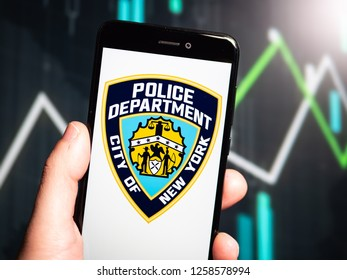 Murcia, Spain; Dic 14, 2018: hand holding phone with New York City Police Department (NYPD) logo displayed in it with fluctuating graphic on background. First person view