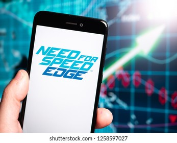 Murcia, Spain; Dic 14, 2018: Need for Speed Edge logo in phone with earnings graphic on background. Need for Speed: Edge is a free-to-play MMO racing game