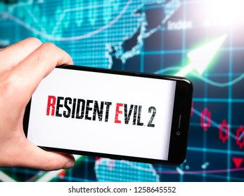 Murcia, Spain; Dic 14, 2018: Resident Evil 2 logo in phone with earnings graphic on background. Resident Evil 2[a] is a survival horror game