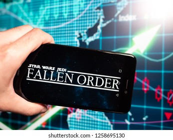 Murcia, Spain; Dic 14, 2018: Stars Wars Jedi Fallen Order logo in phone with earnings graphic on background. Stars Wars Jedi Fallen Order is a single player video game